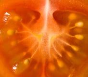 Rebanada de tomate de cereza Foto de archivo libre de regalías