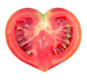 Rebanada de tomate en la dimensión de una variable del corazón Imagenes de archivo