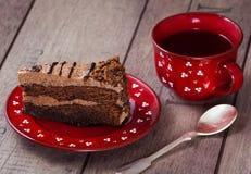 Rebanada de torta con té Fotografía de archivo libre de regalías