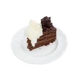 Rebanada de torta de chocolate hecha en casa aislada en blanco con el recortes Foto de archivo libre de regalías