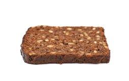 Rebanada de un pan negro aislado Fotografía de archivo