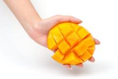 Rebanada del mango disponible Fotografía de archivo libre de regalías