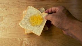 Rebanada del pan con el atasco anaranjado Imágenes de archivo libres de regalías