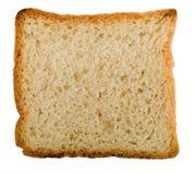 Rebanada del pan del trigo integral Aislado Imágenes de archivo libres de regalías