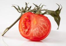 Rebanada del tomate en rama Foto de archivo