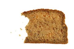 Rebanada entera parcial del pan del grano Foto de archivo libre de regalías
