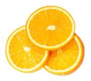 Rebanadas anaranjadas aisladas en el fondo blanco Fotografía de archivo libre de regalías
