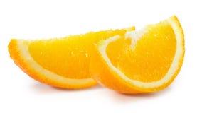 Rebanadas anaranjadas aisladas en el fondo blanco Imágenes de archivo libres de regalías