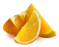 Rebanadas anaranjadas aisladas en el fondo blanco Fotografía de archivo
