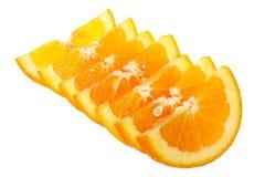 Rebanadas anaranjadas en el fondo blanco Imagenes de archivo