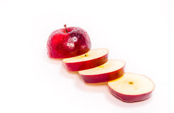 Rebanadas de Apple en rojo Foto de archivo