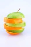 Rebanadas de Apple y de las naranjas Fotografía de archivo