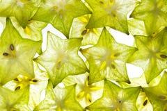 Rebanadas de estrella de la fruta en blanco Fotografía de archivo