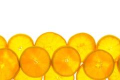 Rebanadas de fruta anaranjada Fotos de archivo