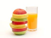 Rebanadas de fruta y de jugo foto de archivo