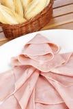 Rebanadas de jamón y de pan españoles Fotos de archivo