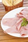 Rebanadas de jamón y de pan españoles Imagen de archivo libre de regalías