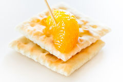 Rebanadas de mandarín con las galletas Imagen de archivo