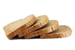 Rebanadas de pan marrón del grano Fotografía de archivo