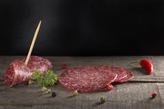 Rebanadas de salami rojo Imagen de archivo libre de regalías