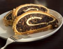 Rebanadas de torta de la amapola Imagenes de archivo