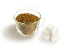 Rebanadas del café instantáneo y del azúcar Foto de archivo libre de regalías