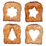 Rebanadas del pan con los agujeros temáticos de diversa Navidad fotos de archivo