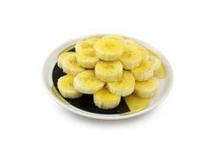 Rebanadas del plátano con la miel Fotografía de archivo