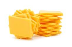 Rebanadas del queso cheddar Fotografía de archivo libre de regalías