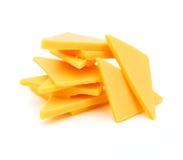 Rebanadas del queso de Cheddar Fotos de archivo