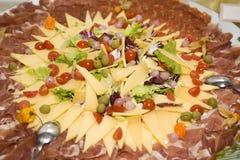 Rebanadas del salami y del queso Imagen de archivo libre de regalías