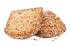 Rebanadas enteras del pan del grano Fotografía de archivo