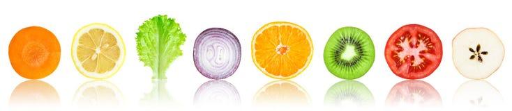 Rebanadas frescas de la fruta y verdura Foto de archivo