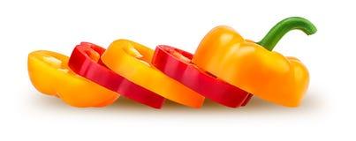 Rebanadas rojas y paprikas amarillos Imagenes de archivo