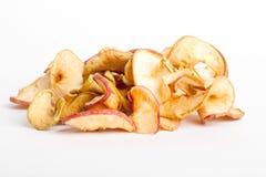 Rebanadas secadas de manzana roja Imagenes de archivo