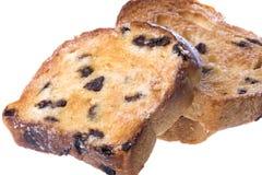 Rebanadas tostadas del pan de pasa aisladas Fotos de archivo