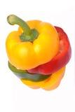 Rebanadas verdes rojas amarillas del paprika Imagen de archivo
