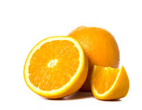 Rebanadas y entero anaranjados Foto de archivo libre de regalías