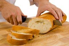 Rebanar el pan Foto de archivo