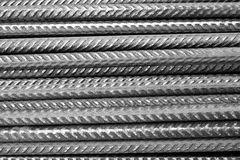 Rebar - black and white - closeup of horizontally stacked steel division reinforcement bars. Vertically aligned steel rods, so called rebar, commonly used in Royalty Free Stock Photos