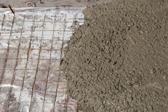 Rebar grids in a concrete floor during a pour. Royalty Free Stock Images
