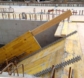 Rebar iron and shawl panels on construction site. Yellow shawl panels and rebar iron and walls prepared for the pouring of a stairwell on a construction site Stock Images