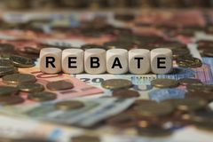 Rebate - cube with letters, sign with wooden cubes Royalty Free Stock Photos