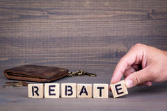 Rebate. Wooden letters on dark background Royalty Free Stock Photo