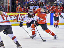 IIHF Women's Ice Hockey World Championship. Rebecca Johnston (6) in action for Team Canada during their comprehensive 13-0 victory over Switzerland in their Royalty Free Stock Photo