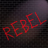Rebel concept. Illustration depicting grafitti on a wall with a rebel concept Stock Image