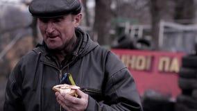 Rebel eat bread. stock video footage