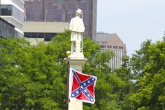Rebel Flag and Confederate Monument  At South Carolina Capitol. Vivid Rebel flag decorates a monument on South Carolina's State Capitol grounds dedicated to Stock Image
