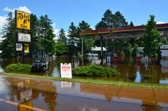 Rebel Gas in Flood. Moose Lake, MN - June 22, 2012 - Rebel Gas station on Arrowhead Lane surrounded by flood waters Royalty Free Stock Photo