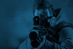 Rebel with gas mask and rifles against a white background Royalty Free Stock Images